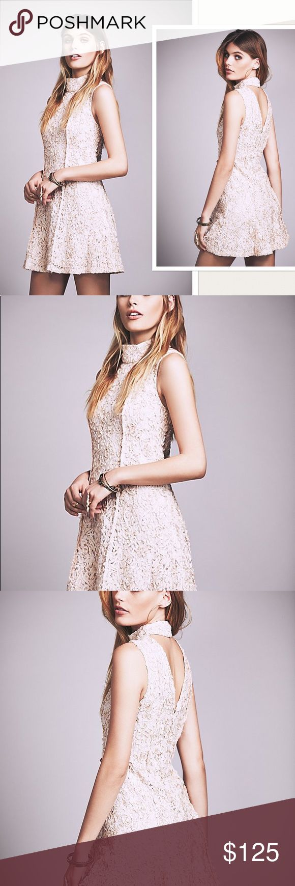 """NWT Free People Anne Mock Neck Mini Dress Embroidered lace adds texture to a sleeveless turtleneck dress constructed with seamed paneling. #115 - Cutout back with hook-and-eye closure - Concealed back zip with hook-and-eye closure - A-line silhouette - Allover embroidered lace construction - Lined Lace: 65% cotton, 35% nylon Embroidery: 100% polyester Lining: 100% polyester Color: Almond Retail: $300.00 Closure: Hidden Back Zipper Dress Length: Above Knee, Mini Total Length: 34 """" Bust…"""