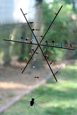 spider web.  I'd use clear beads to look like dew.