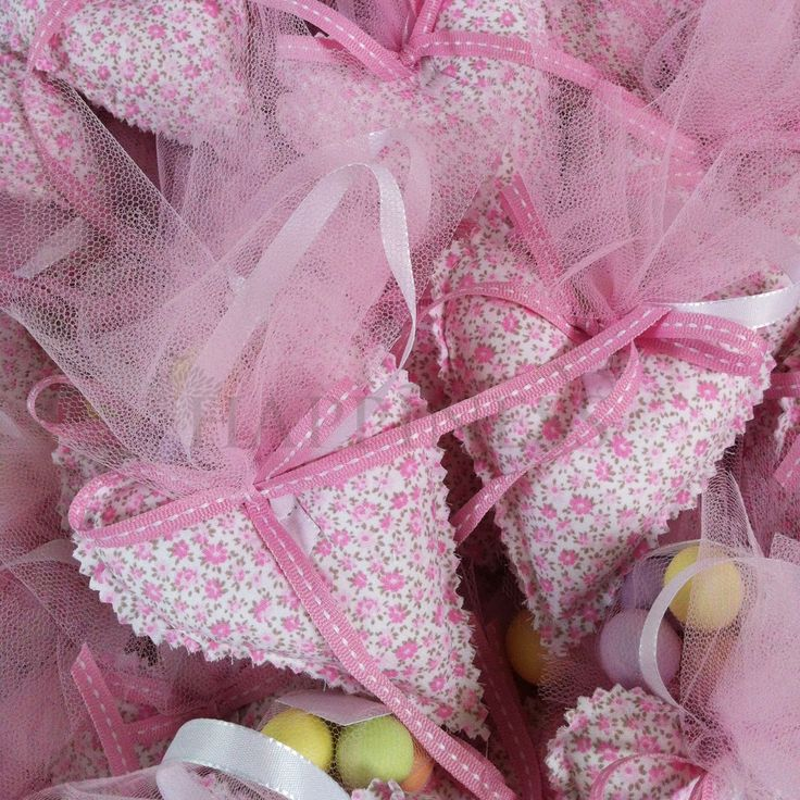 "A beautiful pink heart-shaped favor with ""crunchie dragee (koufeta) for a little girls baptism. These can be tailored to your desires from a large collection of fabrics.   #bomboniera #christening #baptism #dragee #koufeta #hatziyiannakis  For more info: www.myhappiness.gr"