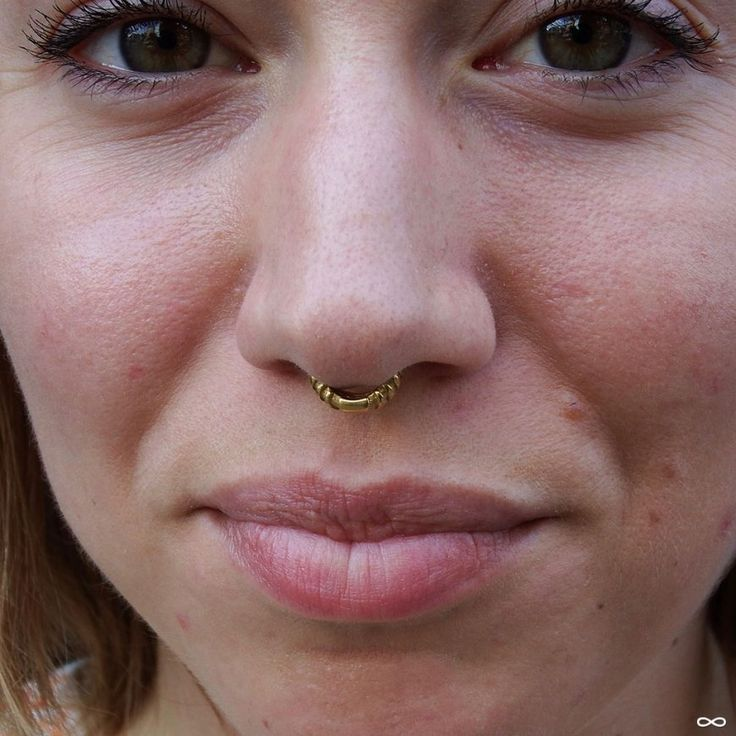 "Septum Piercing by Robert with a ""Chevronelle"" septum clicker from Tether."