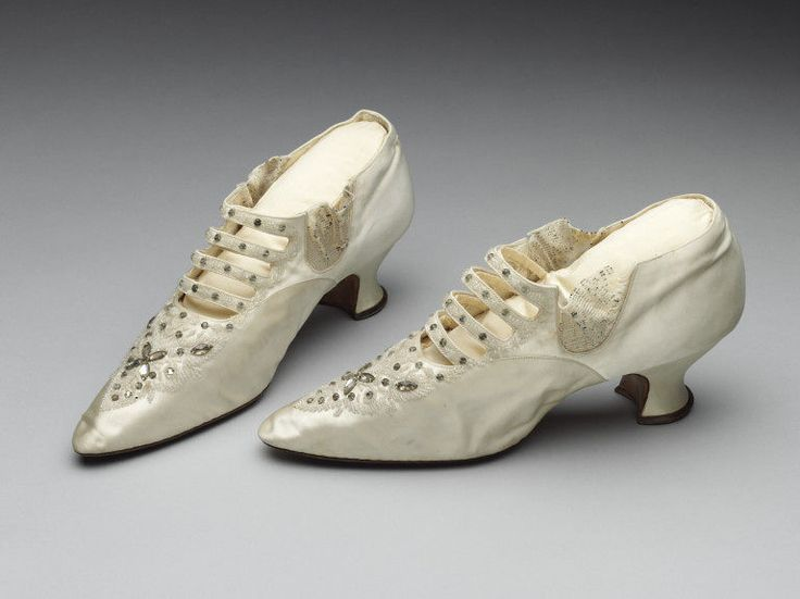1886 White satin wedding shoes with Louis heel, elastic side inserts and ladder vamp, trimmed with beading.