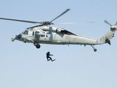 A Diver Is Lowered from An SH-60B Seahawk Helicopter
