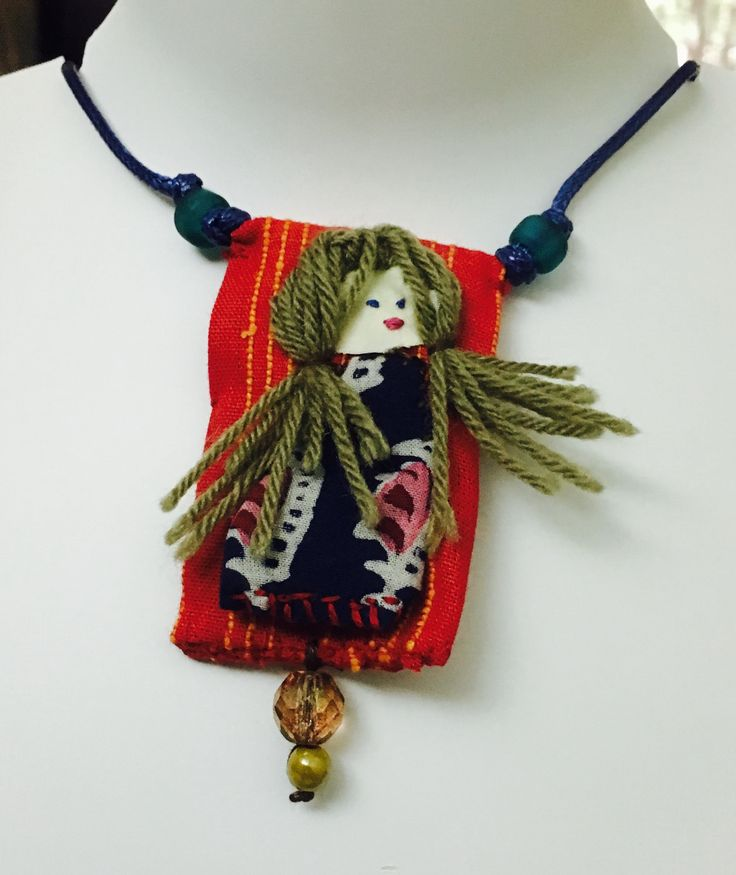 Rag doll theme appliqué pendant on blue waxed cord necklace
