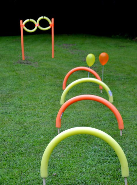 Nerf Party: Obstacle Course.  I think these are pool noodles for the crawling course!