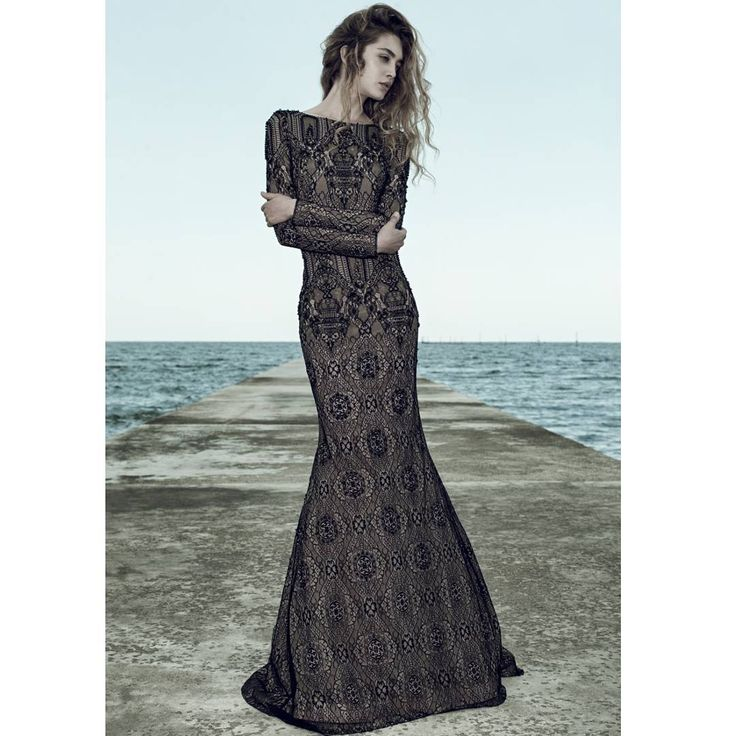 Ersa Atelier hand embroidered french lace long sleeved mermaid silhouette evening dress with Swarovski pearl beading. Astola evening gown from Insulae evening couture collection.
