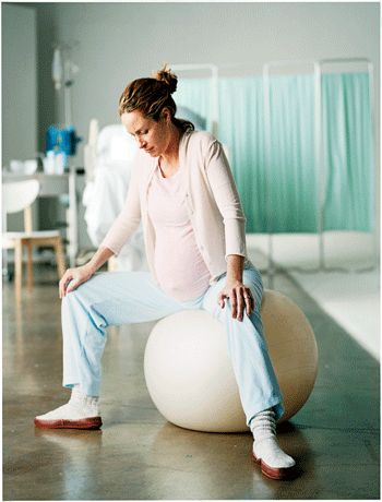 Positions to help you through labor - try sitting on an exercise ball.