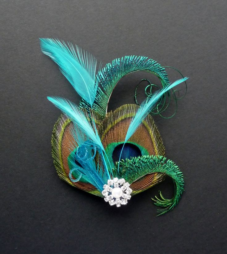 Peacock feather hair clip. Turquoise blue fascinator. 1920's bridesmaids hair accessory - crystal flapper wedding: 'Althea'. £15.99, via Etsy.