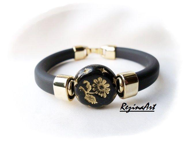 Fekete kaucsuk karkötő arany színű fém köztesekkel és arany virágmintás gyöngydísszel