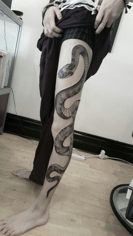 Snake leg tattoo