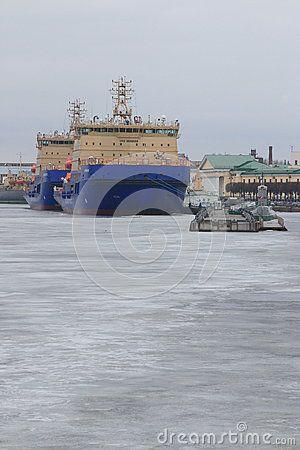 View of icebreakers Murmansk and Vladivostok, moored at the pier of Lieutenant Schmidt Embankment in winter evening. Saint-Petersburg, Russia