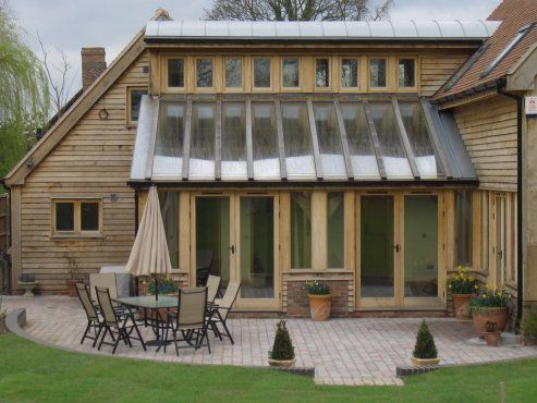 Timber house with stunning oak frame garden room near Tewksbury, UK. By Roderick James Architects