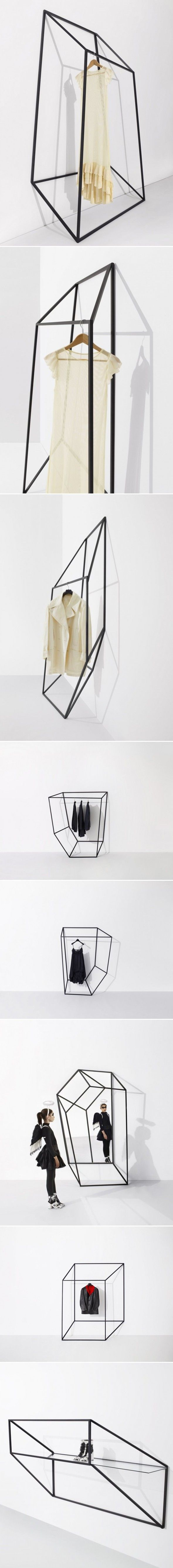 This is very simple and attractive display. The irregular shape of geometric by black lines highlights and attract attention compared to the white wall. The black lines of geometric shapes are made out of steels so that it can also be used as fixtures which also saves space. The 3d form of geometric shapes also creates shadows on the white wall adding extra interest. The overall concept also adds with the brand identity since the merchandise are also simple.