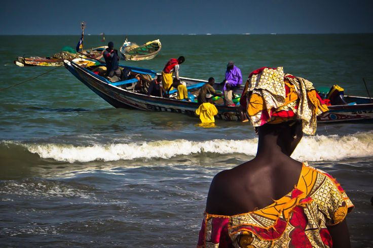 How mesmerizing was Tanji Fish Market, my favorite place in The Gambia. Fishermen boats dancing on the waves, seagulls floating in the air and the women