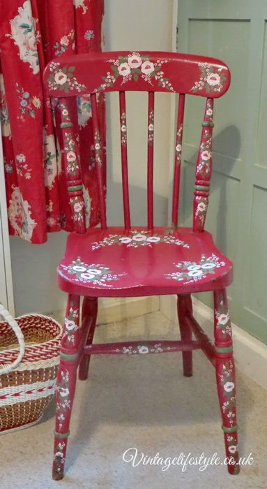Folk art style hand painted vintage chair. Or fabric appliqued to match the drapes.