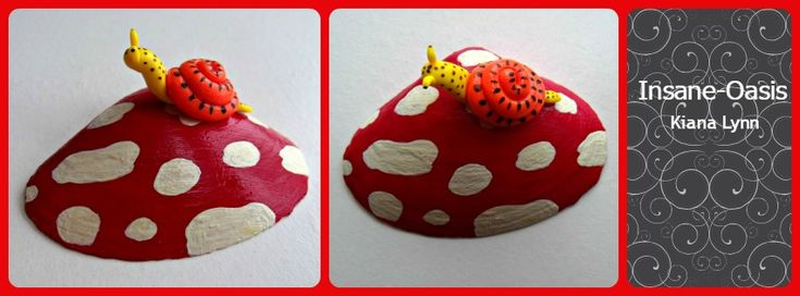 Polymer clay snail sits atop of a seashell painted as a mushroom.