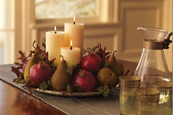 Fall fruit centerpieces - brings in the autumnal thing, but also the colour. Pomegranates, pears, apples, and leaves/greens.