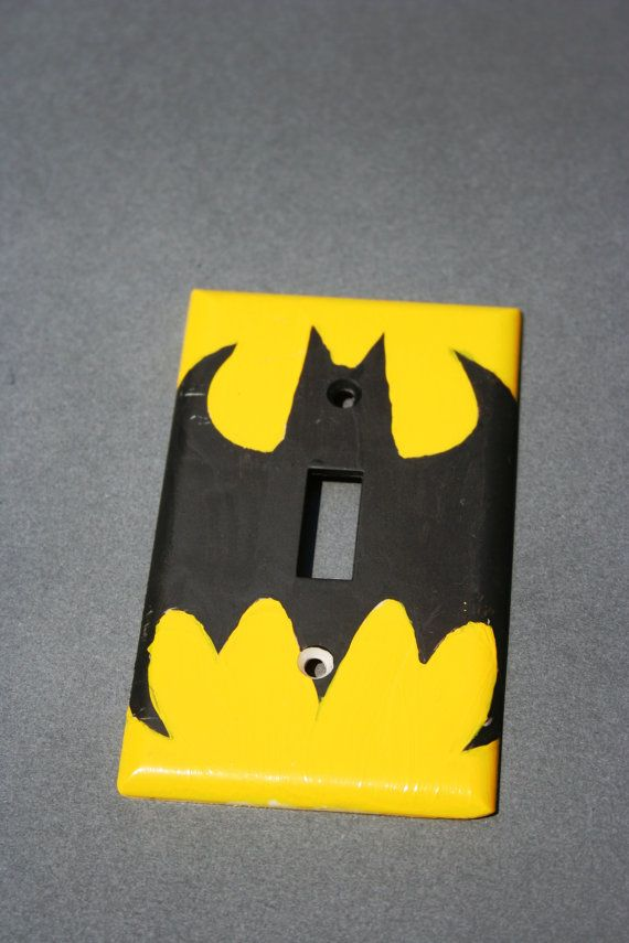 I openly admit I'm a dork, i would love this as the garage light switch. Bat Man Light Covers by NerdyRobots on Etsy, $6.00