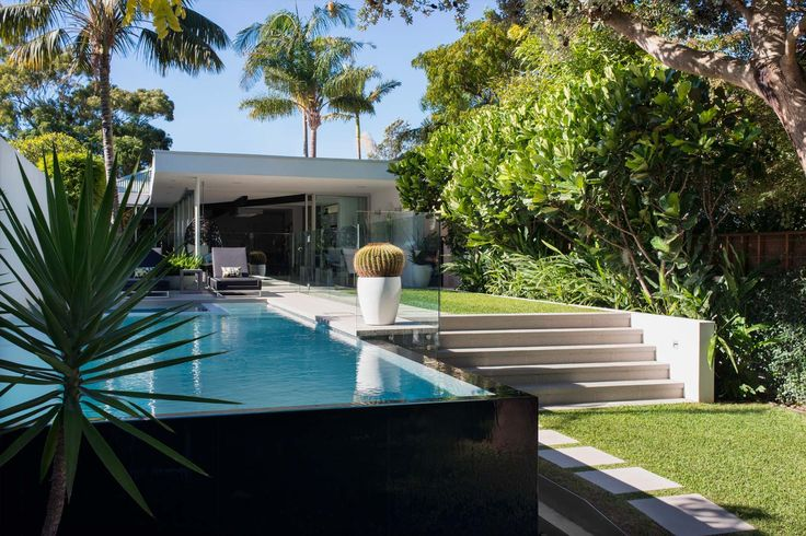 Wide staircase, low raised pool and simple lawn style   Secret Gardens