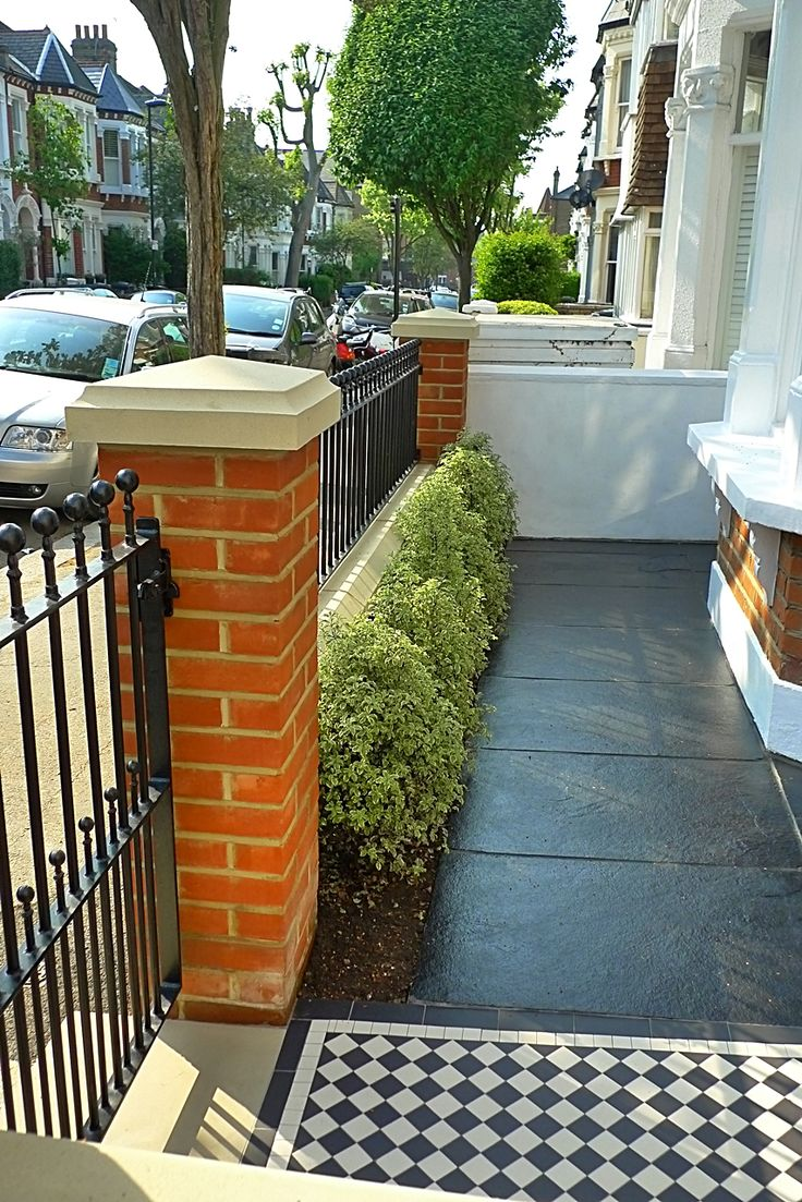victorian front garden design london red rubber brick wall with yellow composite pier cap and mosaic tile path and paving