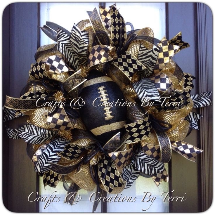 New Orleans Saints Wreath - Fleur de Lis Wreath - Black & Gold Saints Football Wreath - Deco Mesh Wreath - Door Decor - Made To Order by CreatedByTerri on Etsy https://www.etsy.com/listing/204617221/new-orleans-saints-wreath-fleur-de-lis