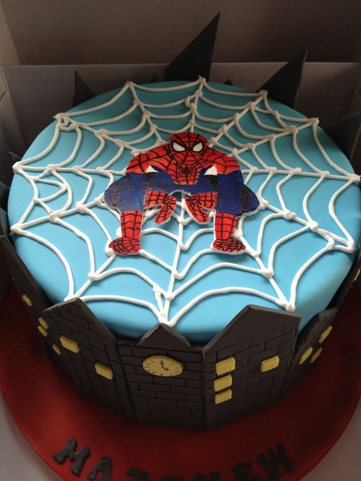 Spiderman Cake I like the city around the edge but maybe that's too much black...