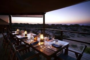 This remote West Australian Safari Camp Sal Salis looks amazing. Nestled in sand dunes in the Cape Range National Park it has access to Australia's longest fringing coral reef. Think experiences like swimming with the whale sharks and snorkelling the World Heritage Ningaloo Reef from just off the shore!.