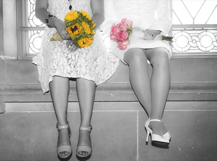 Two brides with their wedding bouquets. #lesbianwedding #twobrides #sanFranciscowedding #sanFranciscocityhall #samesexphotographer www.rachellevinephoto.com