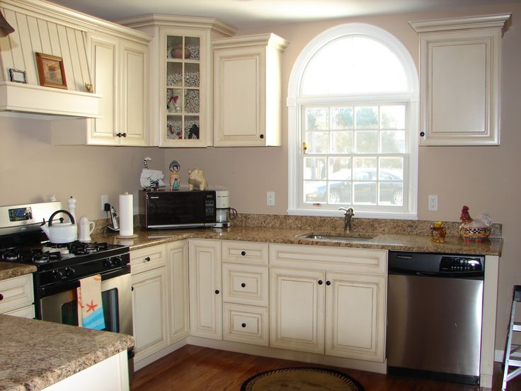 gray walls with distressed cream cabinets and pretty close match to granite countertops. Black Bedroom Furniture Sets. Home Design Ideas