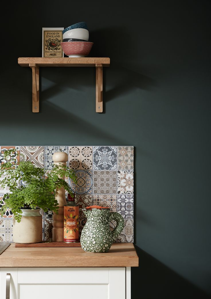 bespoke shelving mosaic tiles greenery and oak finishing touches provide a mediterranean feel to - Landhauskchen Mediterran