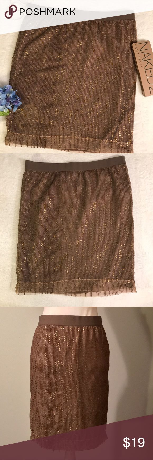 "Gap Brown Gold Sequin Pencil Skirt Gap brown sequin pencil skirt. Dark brown pencil skirt. Elastic pull on waist band. Seamless skirt. Brown sheer overlay with gold tone shimmery sequin detail. Dark brown lining. Size 6. EUC, excellent used condition. Measurements taken laid flat. 16"" waist, 21"" length. GAP Skirts Pencil"