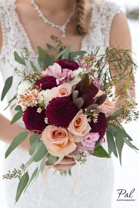 Winter weddings: a bridal bouquet made with peach roses, burgundy chrysanthemums, alstroemeria, carnations and wax flower. Designed by Natasha Price of Paper Peony Alaska. Photo by Pal Photography