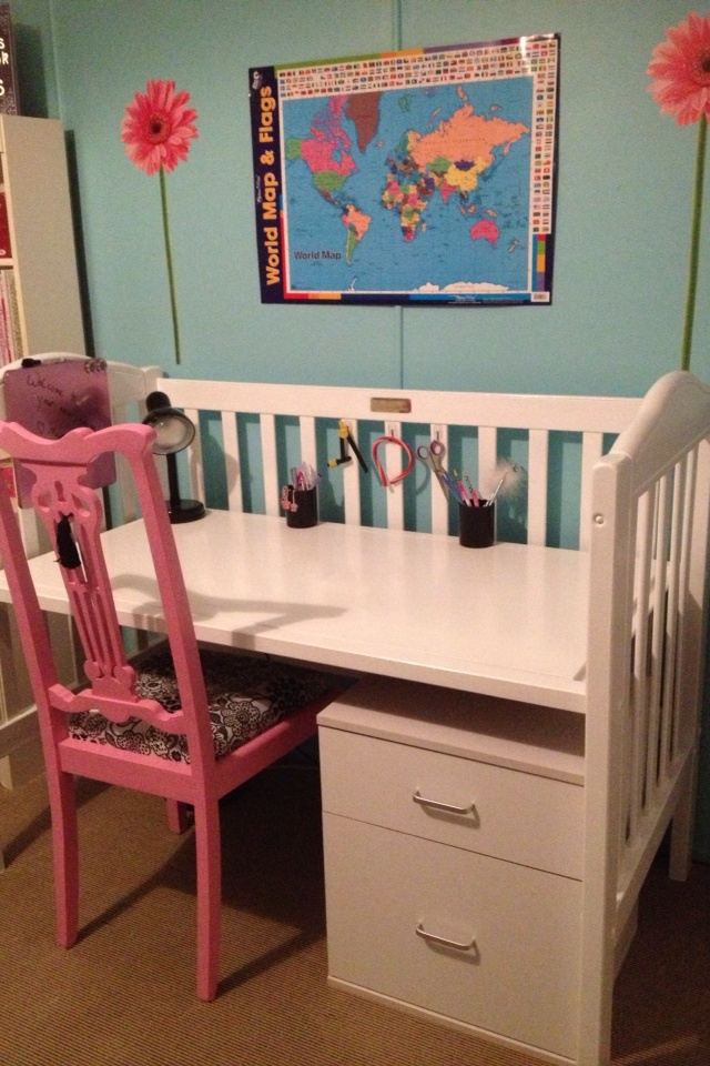 Children's cot turn desk.