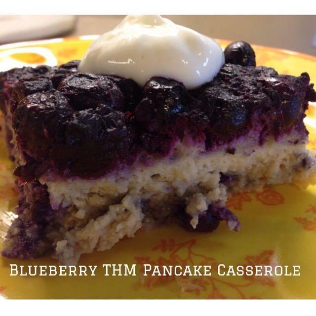 Double the THM E Pancake Batter pg. 223. Add 4 tsp of THM Sweet Blend, 1 tsp of Almond Extract, 2 tsp vanilla to the pancake batter. Cook down 6 cups frozen blueberries in 1 1/2 cups water 2 tsp of THM Sweet Blend for about 30 mins. Pour off save the extra juice from the blueberries. Spray a 9x13 pan, pour blueberries down first then pancake batter on top. Baked 35-40 mins for 350 degrees. Run knife around edge flip over. Cut into 12 squares! I love the THM batter! Soooo versatile!