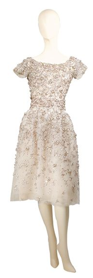 Yves Saint Laurent for Dior Evening Dress  French, 1958  Of dusty pink layered tulle embroidered with metallic pink and silver raffia and pink sequins in foliate motif, boat neck, short sleeves, self belt and full skirt, labeled: Christian Dior/Automne-Hiver 1958/Paris.  Very good condition, refitted by Dior.