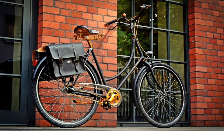 Black old-school bicycle with golden details