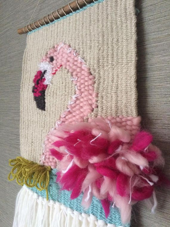 A charming pink flamingo wall hanging. Perfect for a nursery or kids room it is woven with a combination of Merino and cashmere mix yarn and mounted on a lovely branch. Size: H: 52cm (inc hanging yarn - 42cm to branch) W: 21cm (sizes are approx and may vary as this is a handmade item)