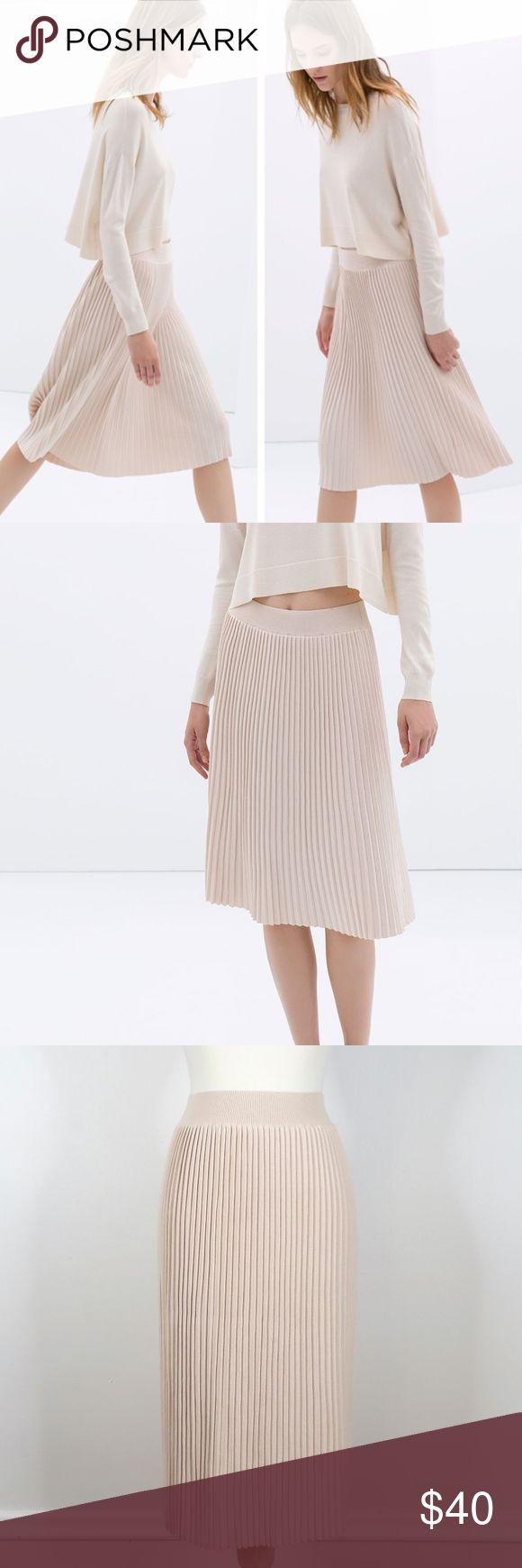 """NWT $80 ZARA KNIT New with tags and no defects.  Style name: Fine Pleat Midi Skirt.   Light pink blush nude color, accordion pleated, hits below knee, medium weight stretch knit.  65% viscose rayon / 35% nylon. Approximately 11.25"""" across at top of waistband and 27.5"""" long along side.   Retails for $80.  One light pink available in size medium.. Black sold out.  Automatically reduce price 20% for 3+ bundles. Zara Skirts Midi"""