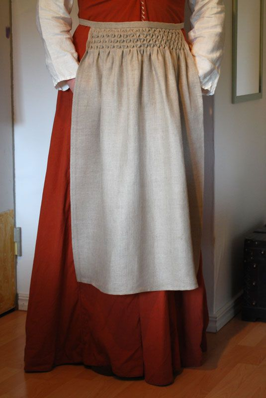 smocked apron- not terribly useful as an apron, but gorgeous simple smocking. Really adds interest to a simple linen article.