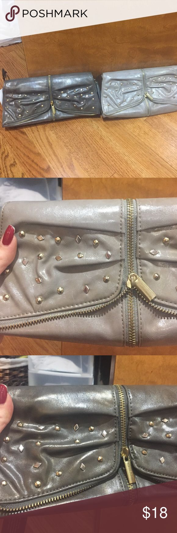 Grey clutches Light and/or dark grey clutches with stud and zipper detail. One for $12/ both for $18 Bags Clutches & Wristlets