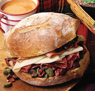 Muffuletta Sandwich - This has been my FAVORITE sandwich since the first time I tried one in New Orleans!        Muffuletta Sandwich Recipe  at Epicurious.com