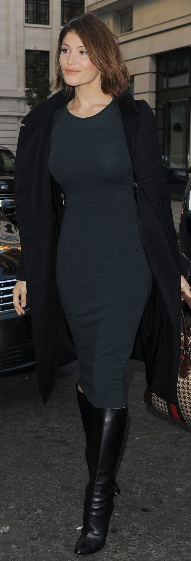 Gemma Arterton in sexy tight black knit dress and black boots