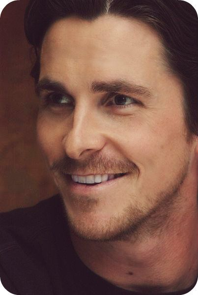 Christian Bale in a lighthearted pose. This is the Harrison that Jerrica thought she was married to - sweet, happy, and in love with his family.