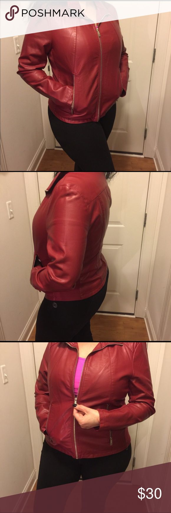Kenneth Cole Faux Leather Jacket in mint condition Gorgeous red faux leather jacket that can be worn with anything.  I've used this jacket a couple of times only and looks brand new.   It can be worn in a black outfit or with virtually anything.  Beautiful color. Kenneth Cole Jackets & Coats Utility Jackets