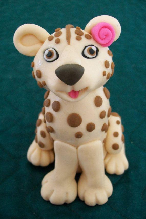 Beautiful Fondant Cheetah Cake Topper. $12.00, via Etsy.