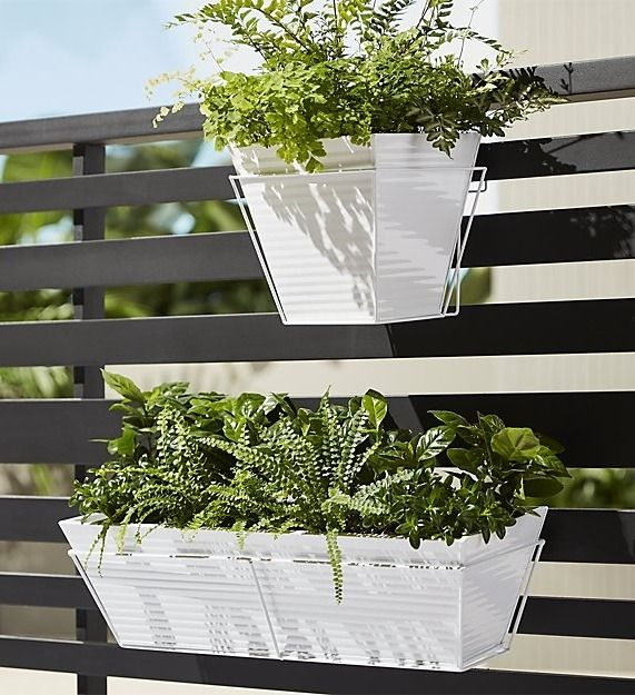 manufacturing plant. Slicked in hi-gloss white, galvanized steel cylinder plants greens in industrial fashion. Ridged, waterproof construction hooks right onto the windowsill with optional oscar rectangular rail frame.
