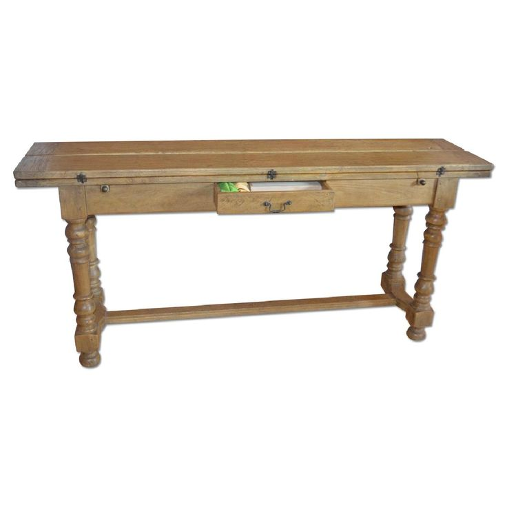 This is a Farm Style Dining Table for $425.00. This farm style table folds out in to a full size table, one or both sides fold up in to a side console. Perfect for city or small space living. Small drawer in front holds candles, knives, napkins.  There is very little wear to this table, as we used it as side board for most of its life. We are moving are not taking it with us!