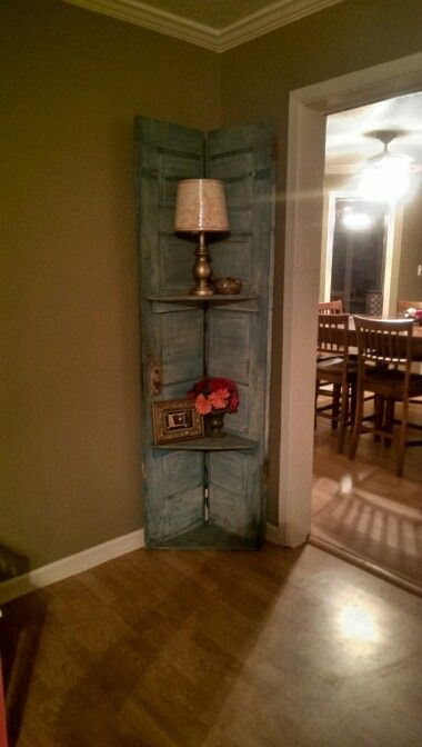 Picked up an old door that was sitting outside in a junk shop. Paid $10 for it. Cut it in half and put hinges on it, wiped it down, put a home-made turquoise glaze on (using wipe off technique),  and then put shelves on... And.. W-a-ll-a... New corner shelf accent piece!