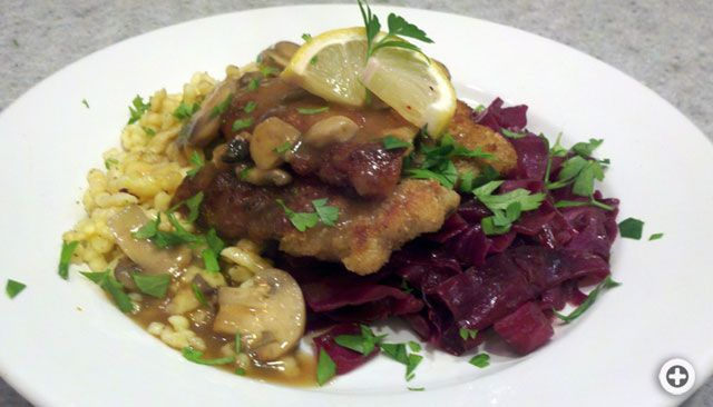 Jagerschnitzel with spaetzle and German red cabbage kraut