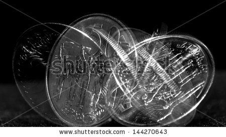 Stroboscopic effect created using flash capturing the motion of a coin as it is spinning - stock photo