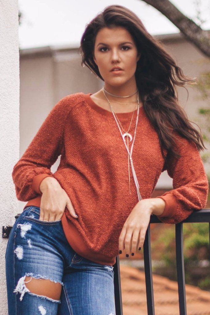Brick red sweater features long sleeves, a soft material, a thick hem, and no lining Material is Polyester Model Ayla is 5'10 wearing amedium Bust Length Small
